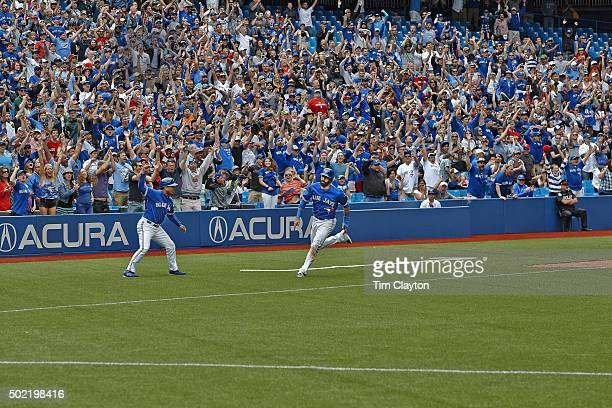 Toronto Blue Jays Jose Bautista in action scoring game winning run with as third base coach Luis Rivera waves him home vs Houston Astros at Rogers...
