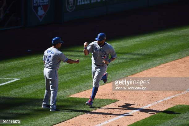 Toronto Blue Jays Kendrys Morales victorious after hitting home run with third base coach Luis Rivera vs Los Angeles Angels at Angel Stadium Anaheim...