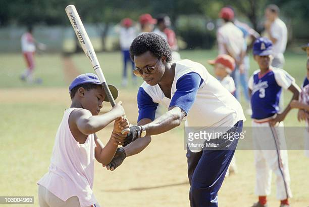Toronto Blue Jays Tony Fernandez teaching Dominican youth player how to hold bat San Pedro De Macoris Dominican Republic 1/17/1986 CREDIT Manny Millan