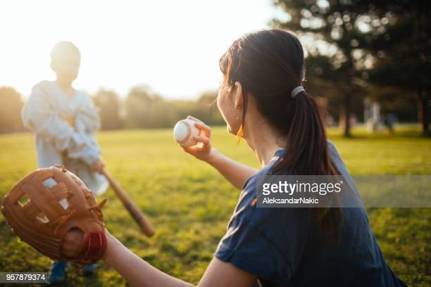 baseball training with my mom - baseball mom stock pictures, royalty-free photos & images
