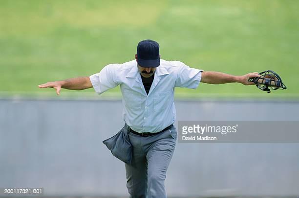 baseball umpire making 'safe' gesture, looking down - 線審 ストックフォトと画像