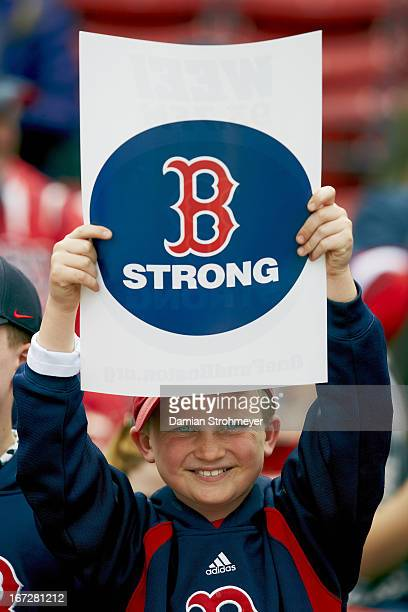 View of Boston Red Sox youth fan holding BOSTON STRONG sign during game vs Kansas City Royals at Fenway Park A ceremony was held before the game in...