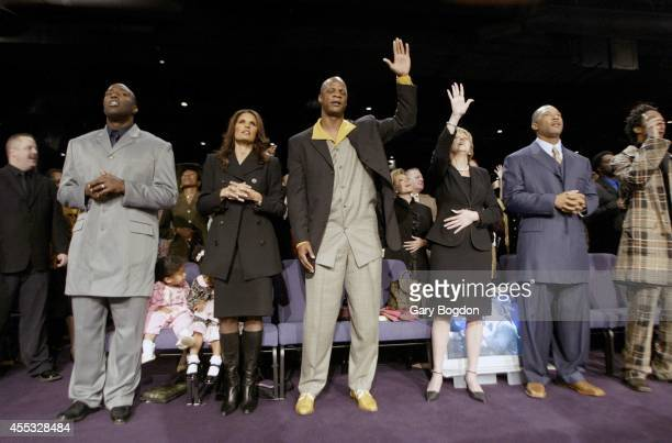 View of former MLB outfielder Darryl Strawberry with his wife Charisse and their 3yearold daughter Jewel during services at Without Walls...