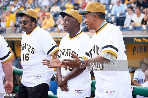 View of former Pittsburgh Pirates players Al Oliver Gene Clines and Dave Cash on field with teammates during the reunion for the 1971 World Champion...