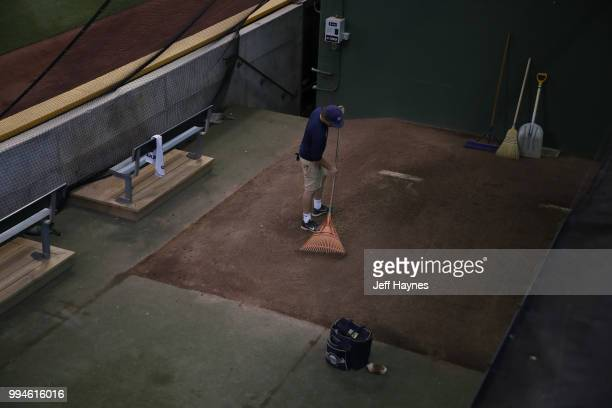 View of ground worker raking in bullpen before Milwaukee Brewers vs Kansas City Royals game at Miller Park Milwaukee WI CREDIT Jeff Haynes