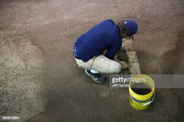View of groundskeeper scraping dirt off rubber mound before Milwaukee Brewers vs Kansas City Royals at Miller Park Milwaukee WI CREDIT Jeff Haynes