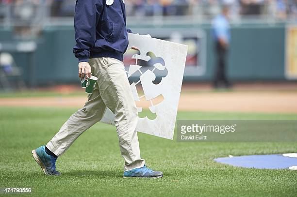 View of Kansas City Royals groundskeeper walking on field with KC stencil to place on mound before game vs New York Yankees at Kauffman Stadium...