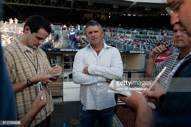 View of San Diego Padres general manager Kevin Towers on field with reporters before game vs Los Angeles Dodgers at Petco Park San Diego CA CREDIT...
