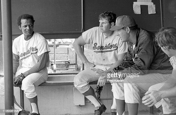 Washington Senators Curt Flood and manager Ted Williams in dugout during spring training at Memorial Park Pompano Beach FL CREDIT Fred Kaplan