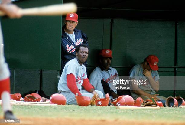 Washington Senators Curt Flood and manager Ted Williams in dugout with team during spring training game vs New York Yankees at Memorial Park Pompano...