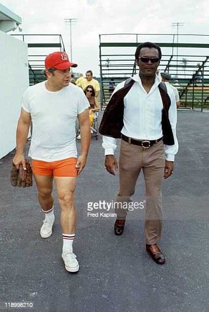 Washington Senators Curt Flood casual walking with manager Ted Williams during spring training at Memorial Park Pompano Beach FL CREDIT Fred Kaplan