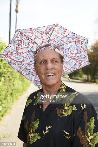 Where Are They Now Casual portrait of charity sports collectibles company owner and former MLB outfielder Jay Johnstone posing with sun umbrella hat...