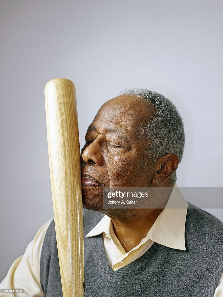 Closeup portrait of MLB Hall of Famer Hank Aaron posing during photo shoot at home. Aaron, who broke Babe Ruth's all-time home run record in 1974, founded 755 Restaurant Corporation, and serves as senior vice president for the Atlanta Braves. Jeffery A. Salter TK1 )