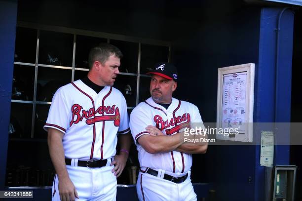 Wild Card Game Atlanta Braves Chipper Jones with manager Fredi Gonzalez in dugout before game vs St Louis Cardinals at Turner Field Final game of...