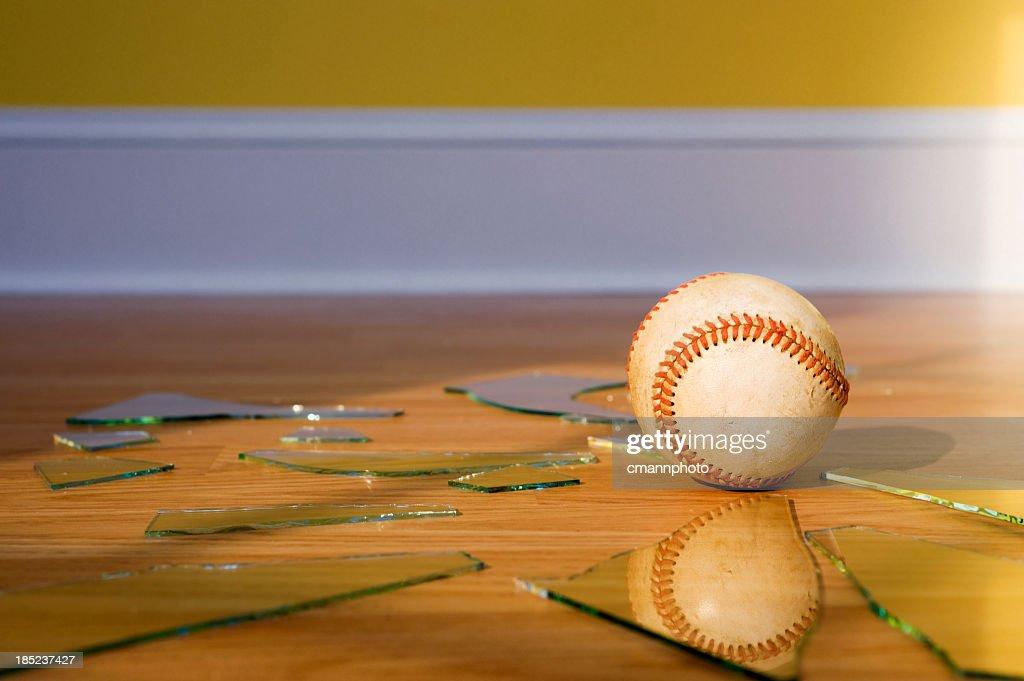 Baseball with Broken Window glass on wood floor : Stock Photo