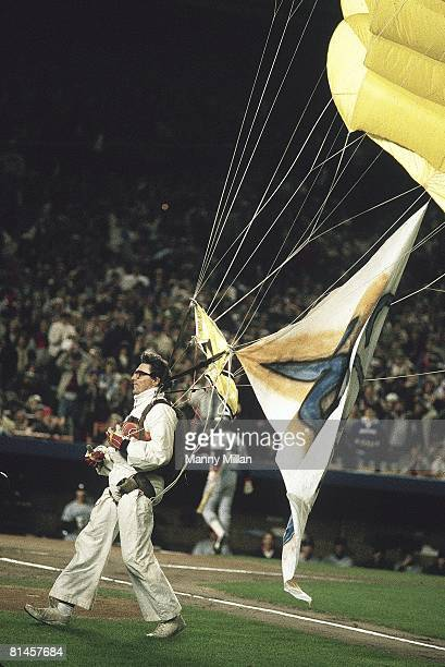 Baseball World Series actor Mike Sergio parachutes onto the field during the top of the 1st inning in Game 6 of the 1986 World Series between the New...