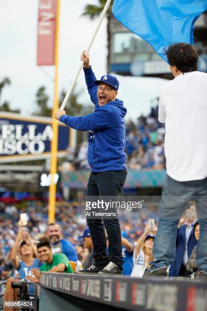 World Series Actor Rob Lowe waving Dodgers flag on top of dugout before Los Angeles Dodgers vs Houston Astros game at Dodger Stadium Game 7 Los...