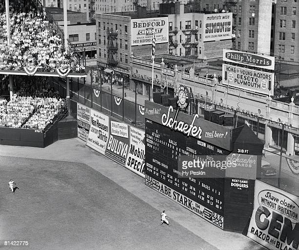 Baseball World Series Aerial view of Brooklyn Dodgers Carl Furillo in action vs New York Yankees View of scoreboard at Ebbets Field stadium Brooklyn...