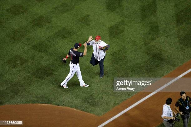 World Series Aerial view of chef Jose Andres with Ryan Zimmerman after ceremonial first pitch before Washington Nationals vs Houston Astros game at...