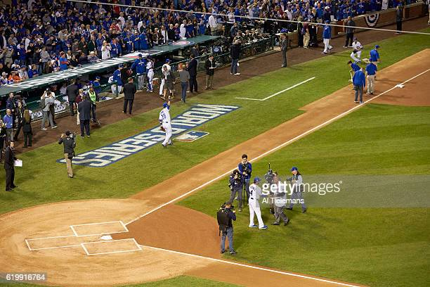 World Series Aerial view of Chicago Cubs bench coach Dave Martinez shaking hands with former Chicago Cubs player Billy Williams after ceremonial...