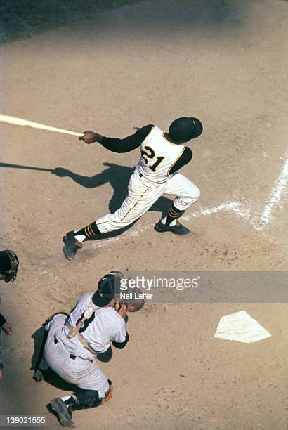 World Series Aerial view of Pittsburgh Pirates Roberto Clemente in action at bat vs New York Yankees Yogi Berra at Forbes Field Pittsburgh PA...