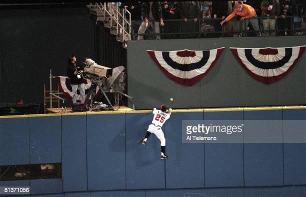 Baseball World Series Atlanta Braves Andruw Jones in action climbing wall and attempting catch vs New York Yankees game tying home run Atlanta GA