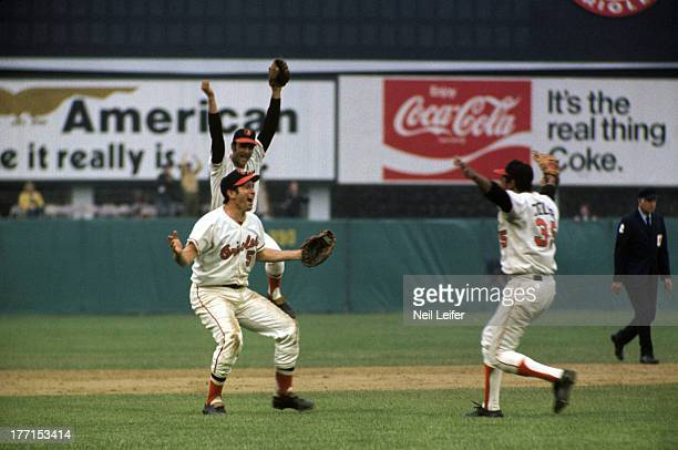 World Series Baltimore Orioles Brooks Robinson and Mike Cuellar victorious on field after winning Game 5 and championship series vs Cincinnati Reds...