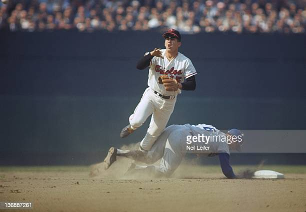 Baseball World Series Baltimore Orioles Davey Johnson in action turning double play vs Los Angeles Dodgers Ron Fairly at Dodger Stadium Game 3...