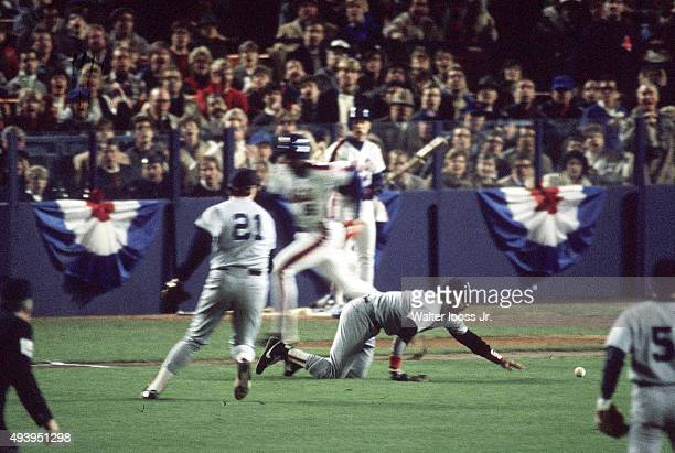 World Series Boston Red Sox Bill Buckner in action crawling to get ball vs New Mets Dwight Gooden running after bunt at Shea Stadium Game 2 Flushing...