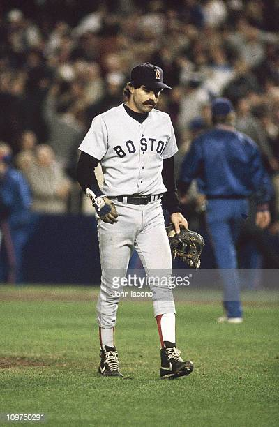 World Series Boston Red Sox Bill Buckner walking off field after a ground ball hit by New York Mets Mookie Wilson went through his legs at 1st base...