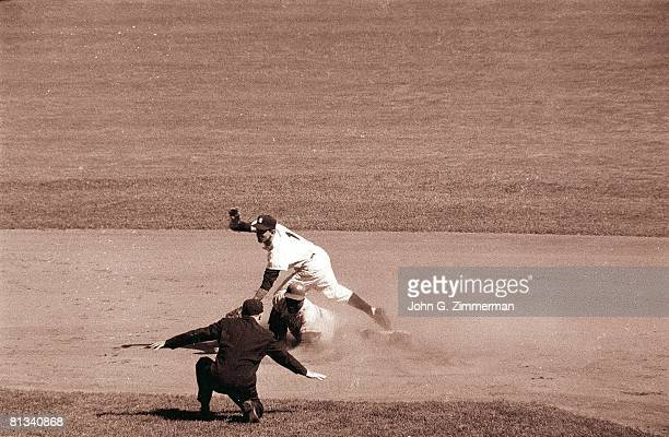 Baseball World Series Brooklyn Dodgers Jackie Robinson in action sliding safely vs New York Yankees Billy Martin Bronx NY 10/6/1956