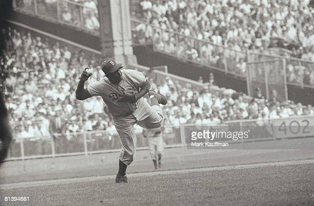 Baseball World Series Brooklyn Dodgers Jackie Robinson in action making throw vs New York Yankees Bronx NY 9/28/195510/4/1955