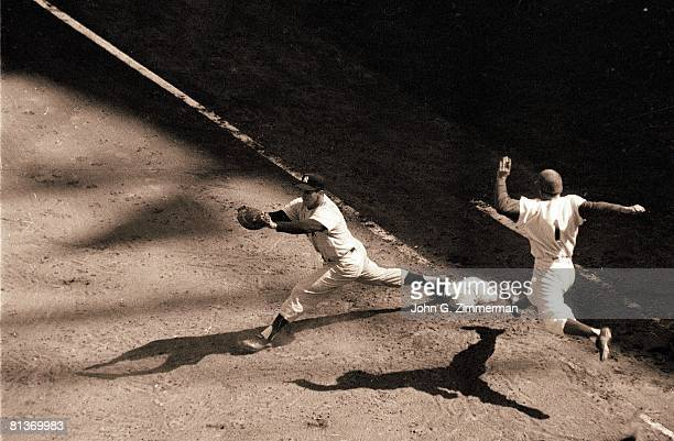Baseball World Series Brooklyn Dodgers Pee Wee Reese in action beating out throw vs New York Yankees Joe Collins Brooklyn NY 10/3/1956