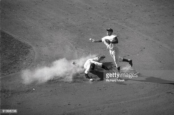 World Series Brooklyn Dodgers Pee Wee Reese in action turning double play vs New York Yankees Mickey Mantle Game 2 Brooklyn NY 10/5/1956 CREDIT...