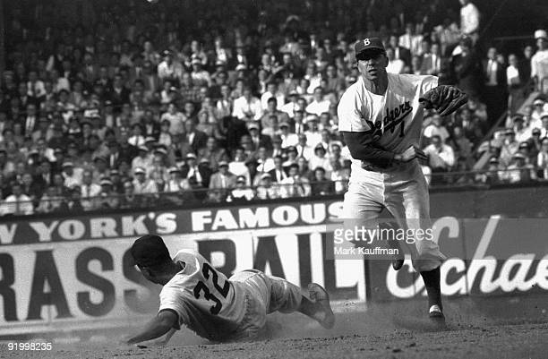 World Series Brooklyn Dodgers Pee Wee Reese in action turning double play vs New York Yankees Elston Howard Game 5 Brooklyn NY 10/2/1955 CREDIT Mark...