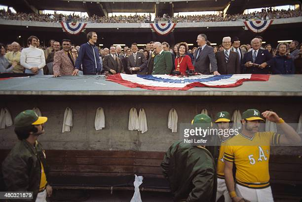 World Series California Governor Ronald Reagan throws ceremonial first pitch as Oakland Athletics owner Charlie Finley First Lady Nancy Reagan and...
