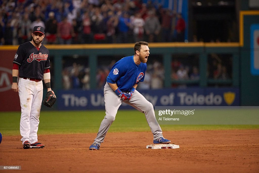 Chicago Cubs Ben Zobrist (18) victorious at second base after hitting RBI double in 10th inning of Game 7 vs Cleveland Indians at Progressive Field. Sequence. Al Tielemans TK7 )