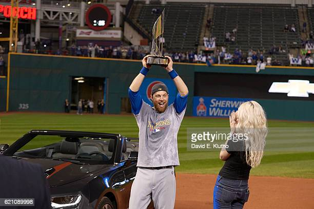 World Series Chicago Cubs Ben Zobrist victorious holding up MVP trophy after winning game and series vs Cleveland Indians at Progressive Field Game 7...