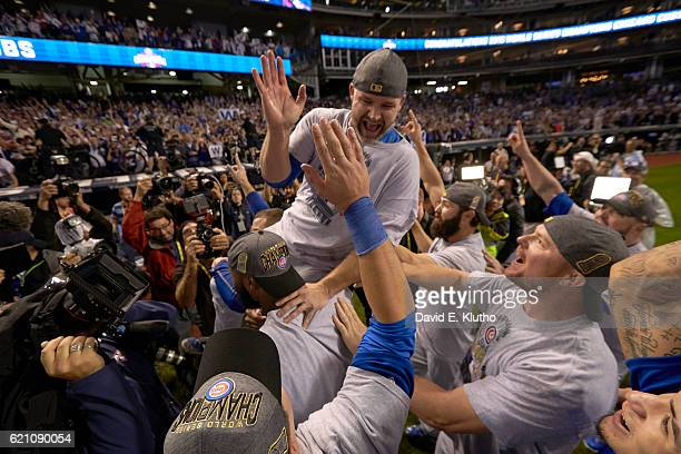 World Series Chicago Cubs David Ross victorious being carried by teammates on field after winning game and series vs Cleveland Indians at Progressive...