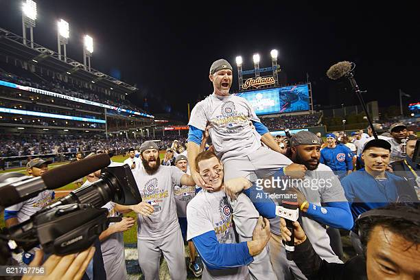 World Series Chicago Cubs David Ross victorious being carried by Antony Rizzo and Jason Heyward after winning game and series vs Cleveland Indians at...