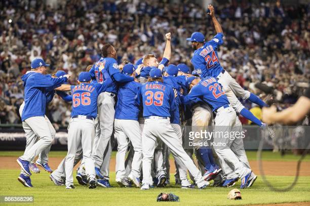 World Series Chicago Cubs Dexter Fowler and teammates victorious on field after winning Game 7 in 10th inning to win championship series vs Cleveland...