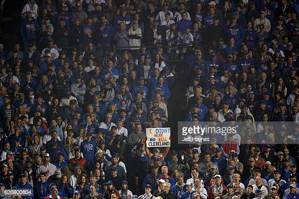 World Series Chicago Cubs fan in stands holding up sign that reads I DIDN'T HEAR NO BELL CLEVELAND during game vs Cleveland Indians at Wrigley Field...