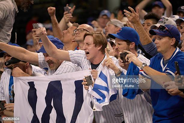 World Series Chicago Cubs fans holding W flag in stands during game vs Cleveland Indians at Progressive Field Game 6 Cleveland OH CREDIT David E...