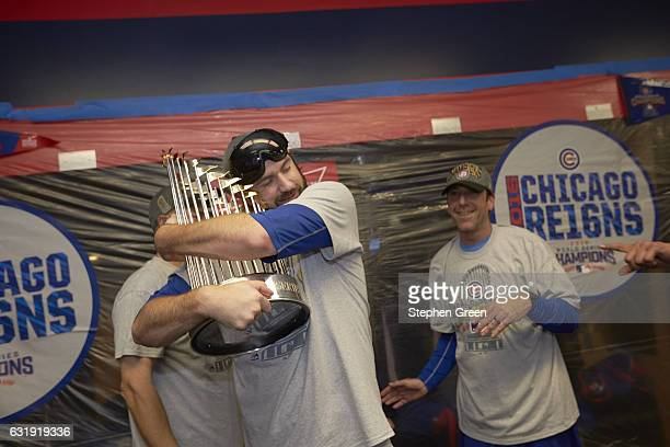 World Series Chicago Cubs Jason Hammel victorious hugging trophy in locker room after winning series vs Cleveland Indians at Progressive Field Game 7...