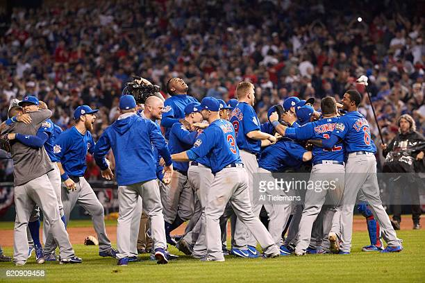 World Series Chicago Cubs players victorious on field after winning Game 7 in 10th inning to win championship series vs Cleveland Indians at...