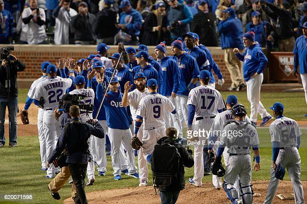 World Series Chicago Cubs players victorous on field after winning game vs Cleveland Indians at Wrigley Field Chicago IL CREDIT David E Klutho