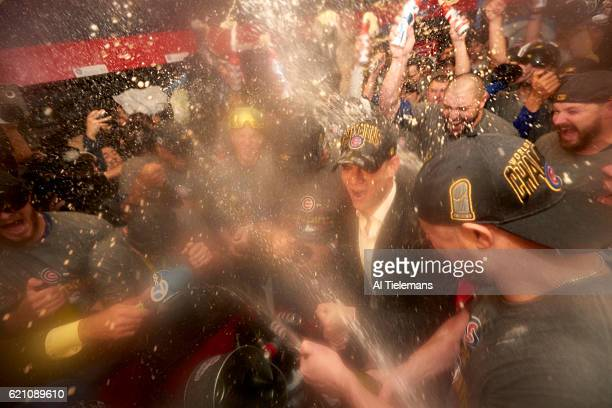 World Series Chicago Cubs President of baseball operations Theo Epstein victorious with champagne in locker room after winning game and series vs...