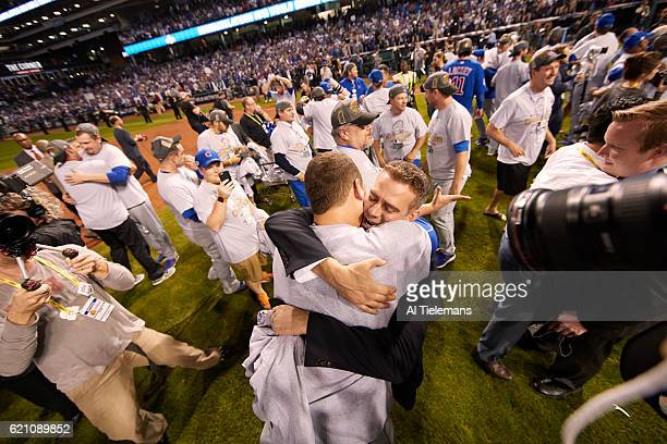 World Series Chicago Cubs President of baseball operations Theo Epstein victorious hugging Anthony Rizzo on field after winning game and series vs...