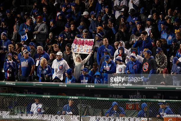 World Series Chicago Cubs young fan in stands holding up sign that read CHICAGO GO CUBS during game vs Cleveland Indians at Wrigley Field Chicago IL...