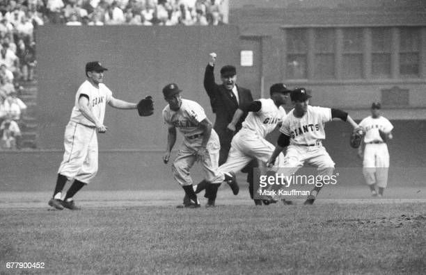 World Series Cleveland Indians Bobby Avila called out in rundown vs New York Giants Alvin Dark Hank Thompson and Davey Williams during Game 2 at Polo...